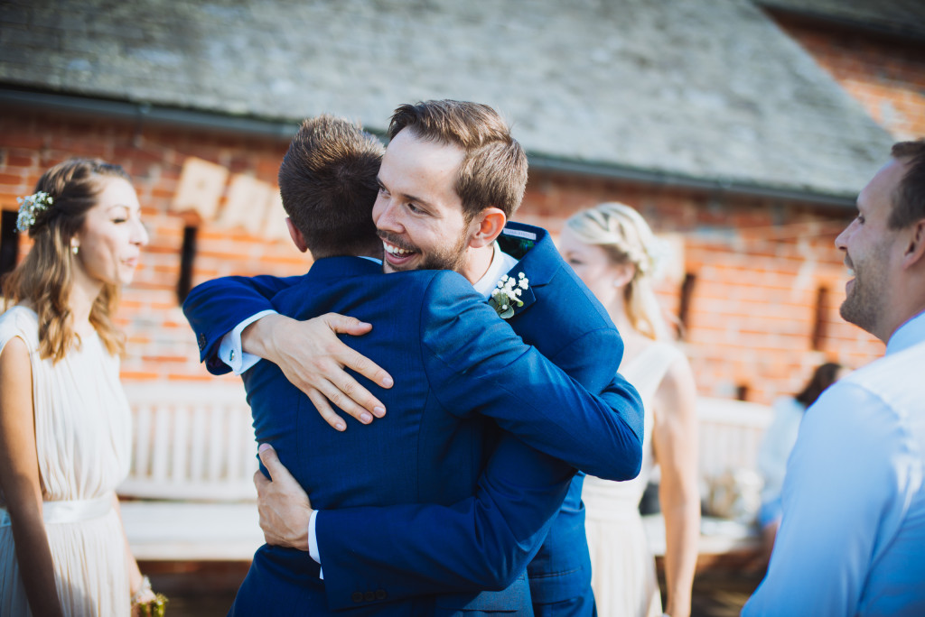 The Groom hugs his Best Man at Wasing Park, Berkshire.