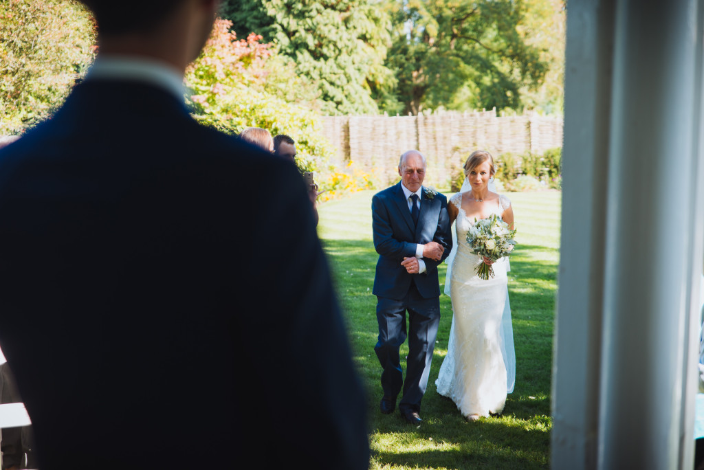 Danielle's father escorts her down the aisle.