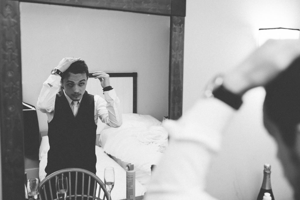 The groom makes his final preparations.